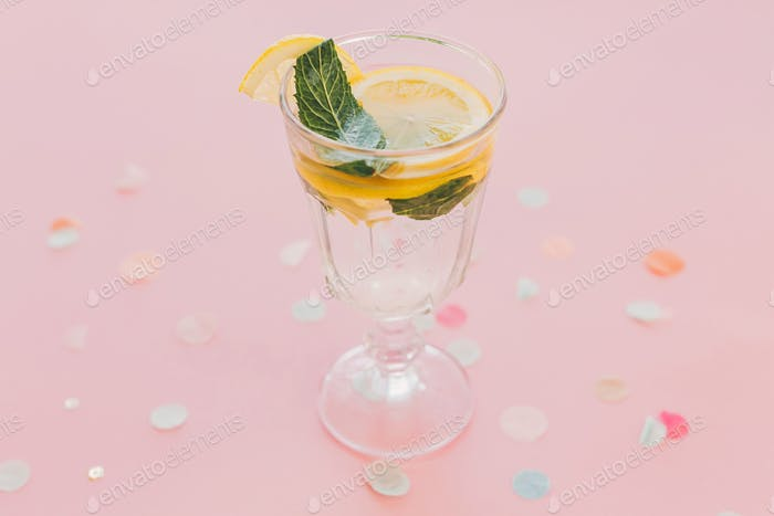 Fresh cocktail with lemon and mint in vintage glass