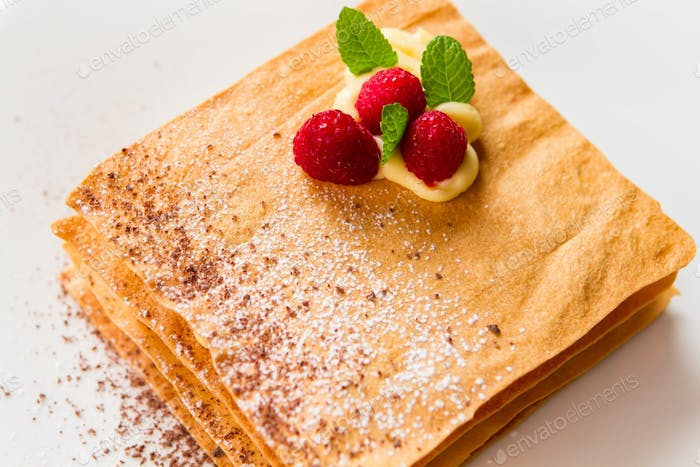 Pastry with mint and berries
