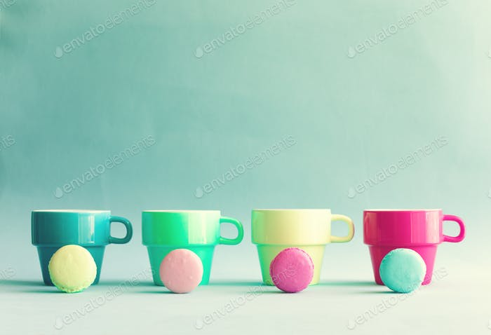 Pastel French Macaroons and tea cups