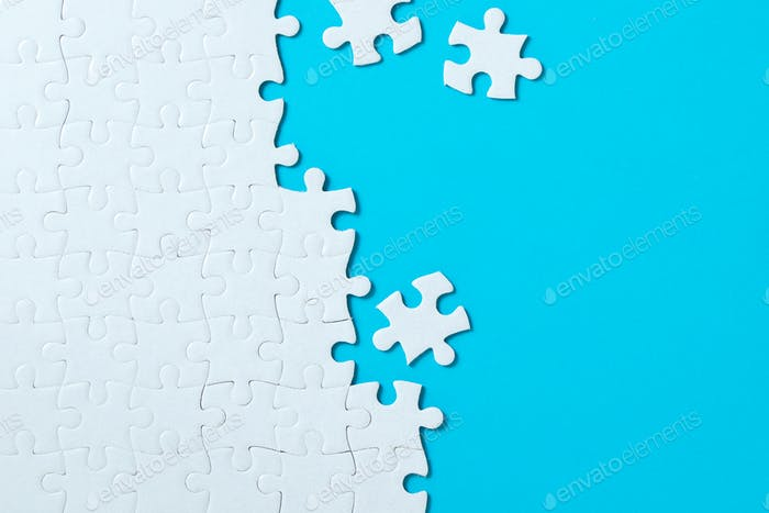 Jigsaw puzzle pieces on blue background