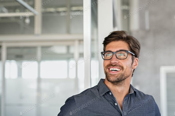 Happy businessman having idea at office