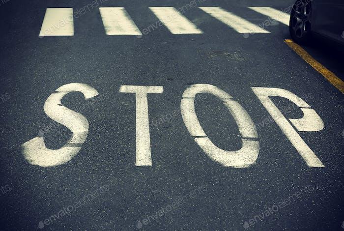 City crosswalk with symbol stop