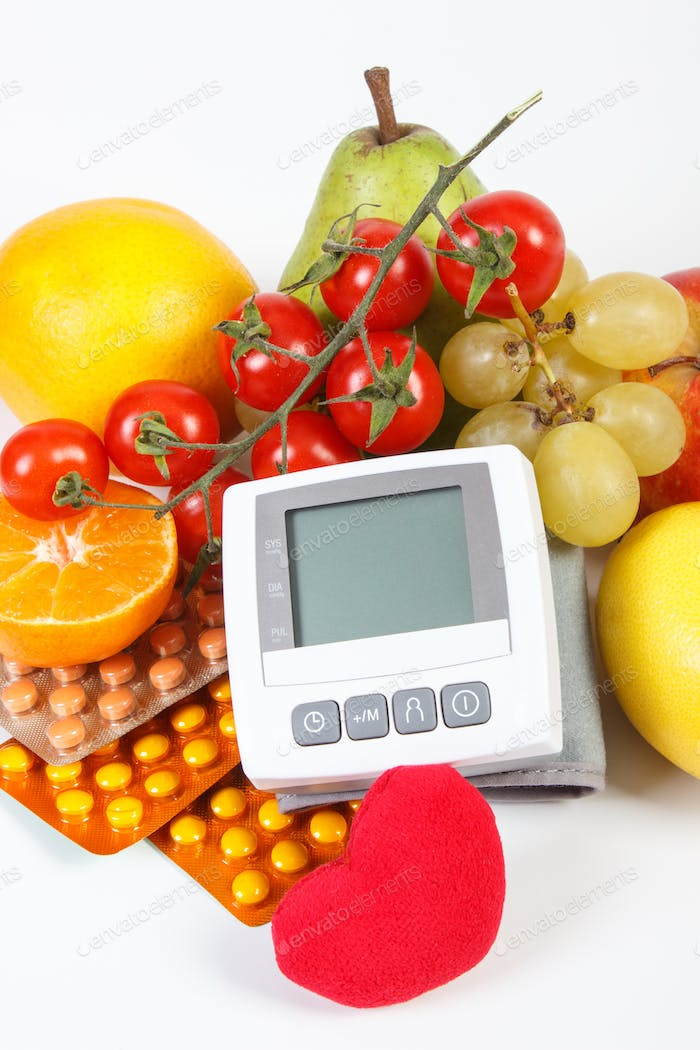 Blood pressure monitor, fruits with vegetables and medical pills, concept of healthy lifestyle