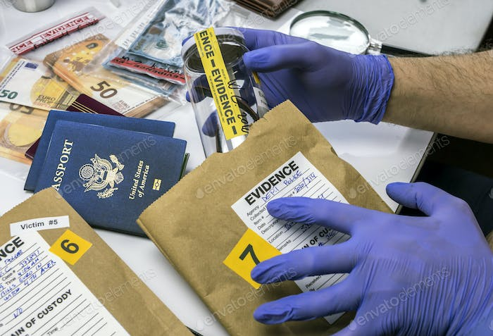 Expert police officer examining American passport of a evidence bag