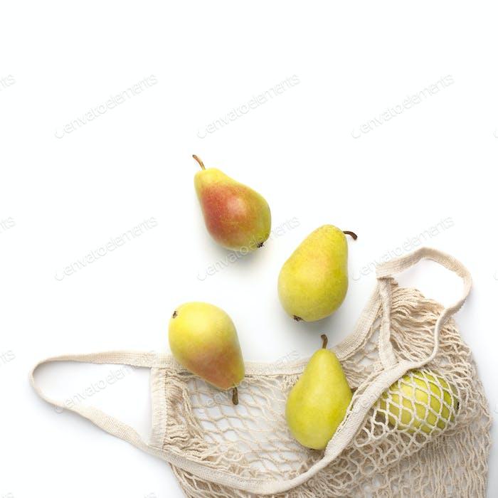 Raw fresh juicy pears inside string reusable shopping bag