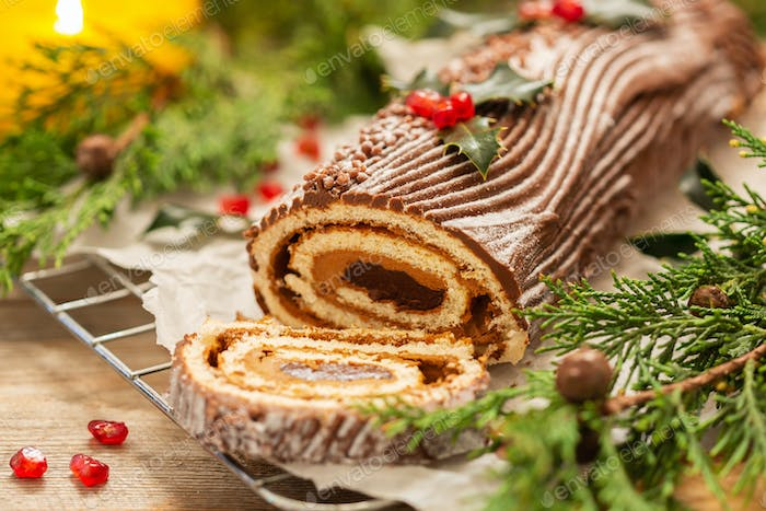 Traditional Christmas cake, chocolate Yule log with festive decorations