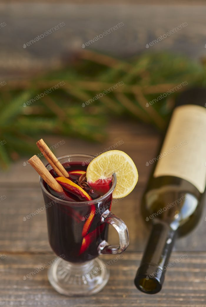 Warming up by having glass of mulled wine