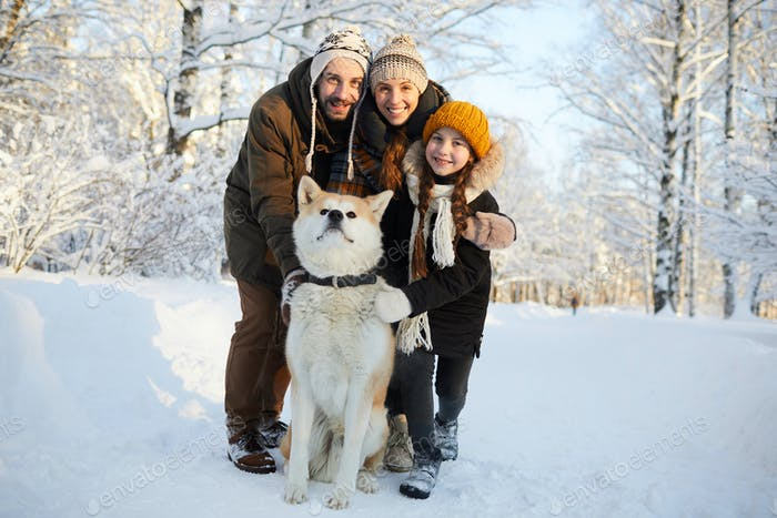 Family Posing with Dog Outdoors