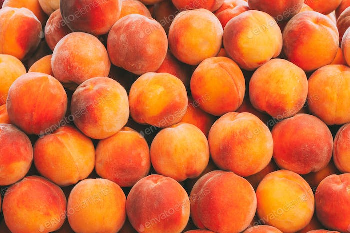 Peaches Fruits Background In The Grocery Market. Healthy And Tas