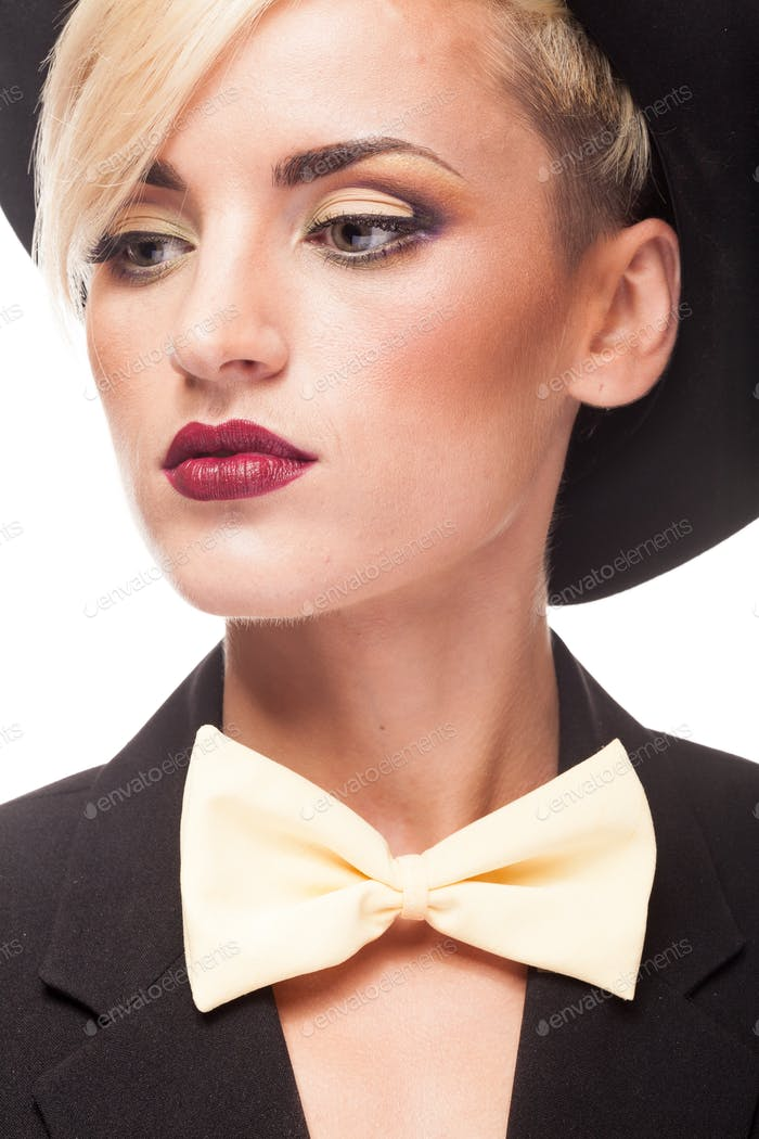 Portrait of beautiful woman wearing hat and bow