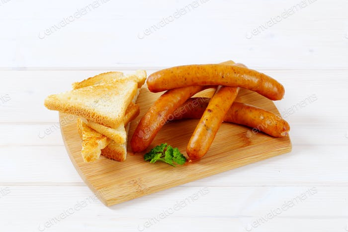 thin sausages with toast
