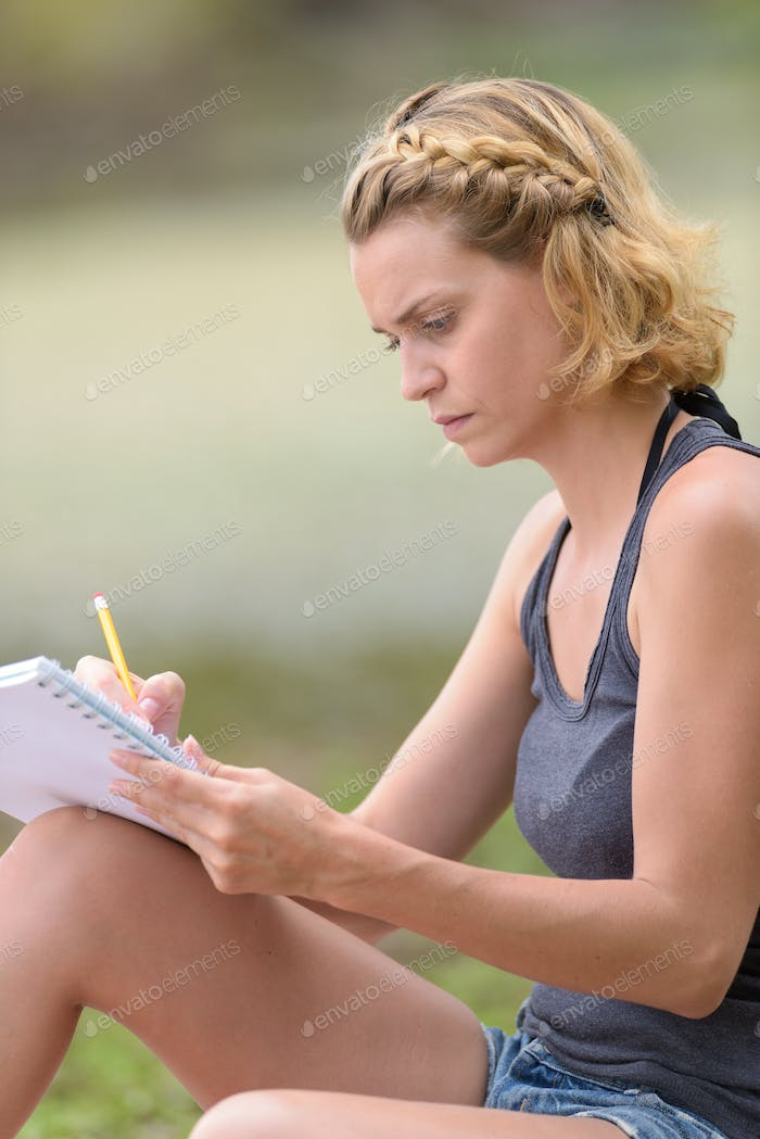 women write note at outdoor in the garden