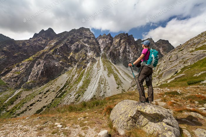 Hiking woman admiring the beauty of rocky Tatra mountains