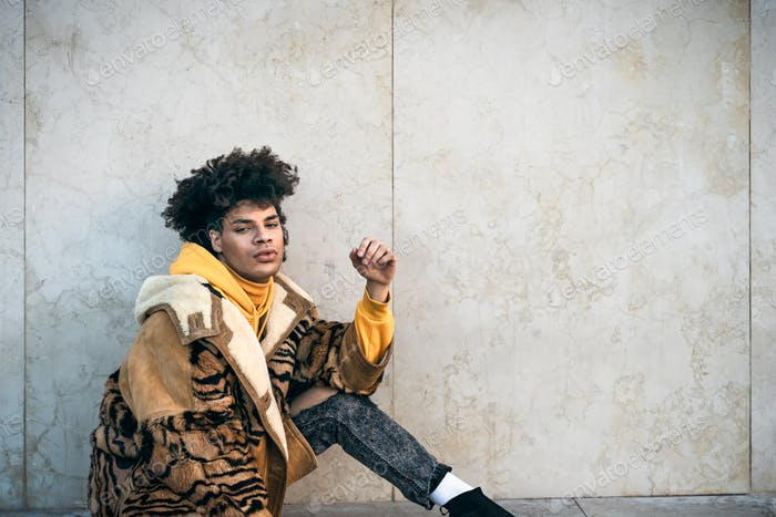 Young Afro gay man posing while looking into the camera