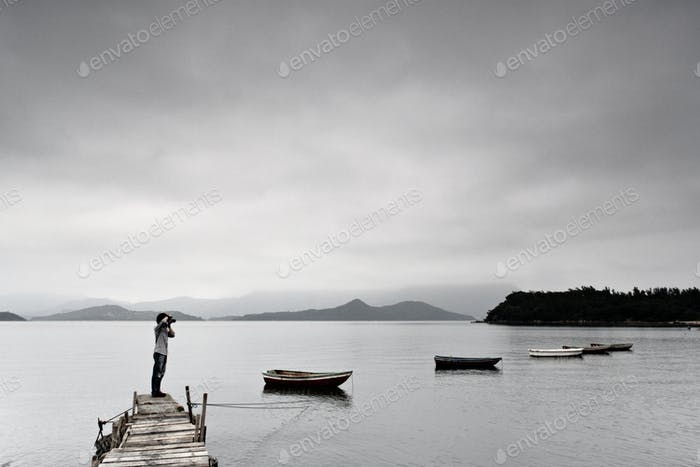 lonely man taking photo