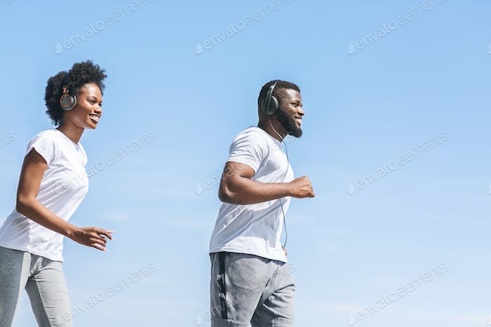 Smiling Afro Spouses Jogging Outside In The Morning