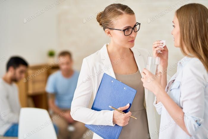 Psychiatrist Comforting Crying Young Woman