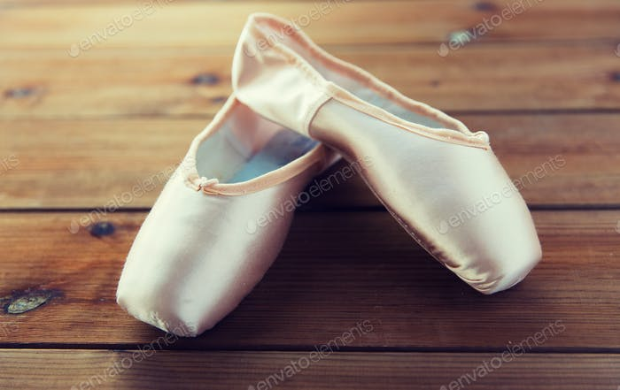 close up of pointe shoes on wooden floor
