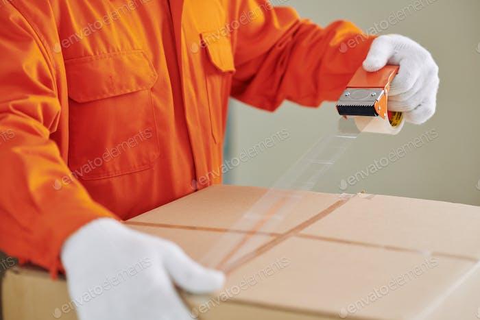Moving Man Taping Box