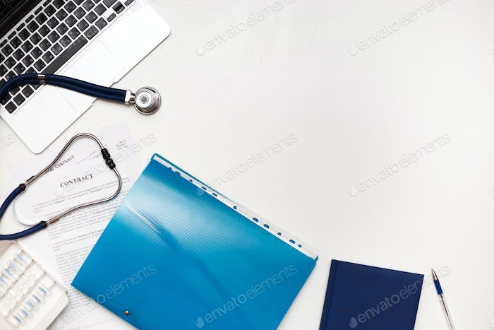 Medical business accessories on doctor's workplace