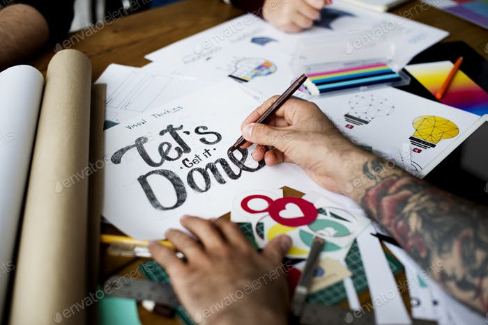Hands Writing Let's Get It Done Pharse on Paper Art Design
