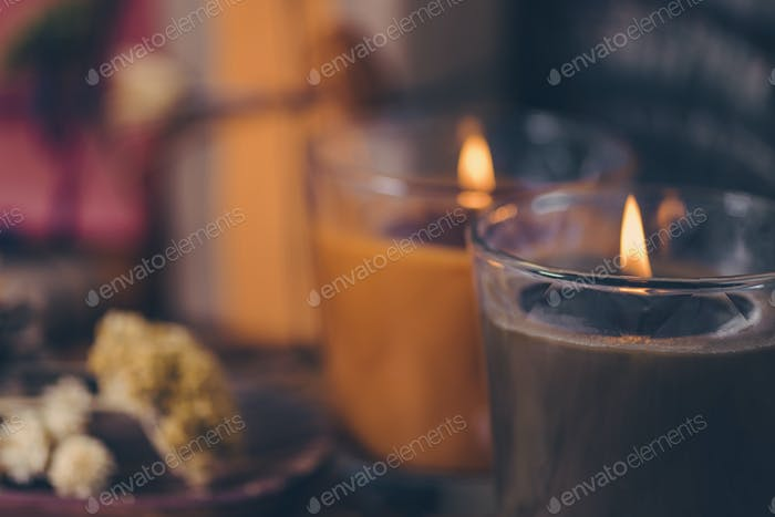 Scented Candles, Presents, Dried Flowers and Leaf Decoration on a Table