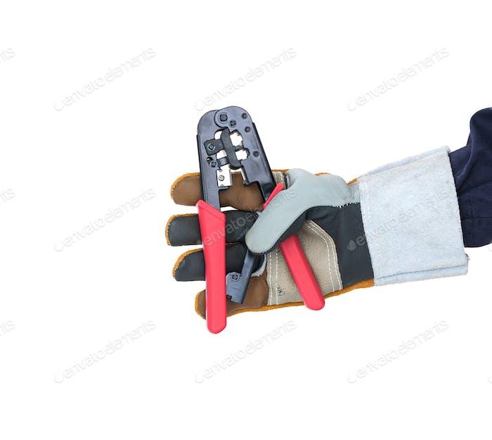 Hand in glove holding wire stripper on white