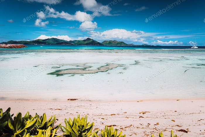 Tropical famous Anse Source d'Argent beach on sunny day on island La Digue in Seychelles
