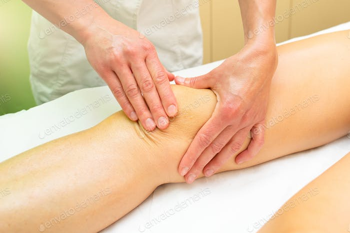 Beautician practices a relaxing knee massage