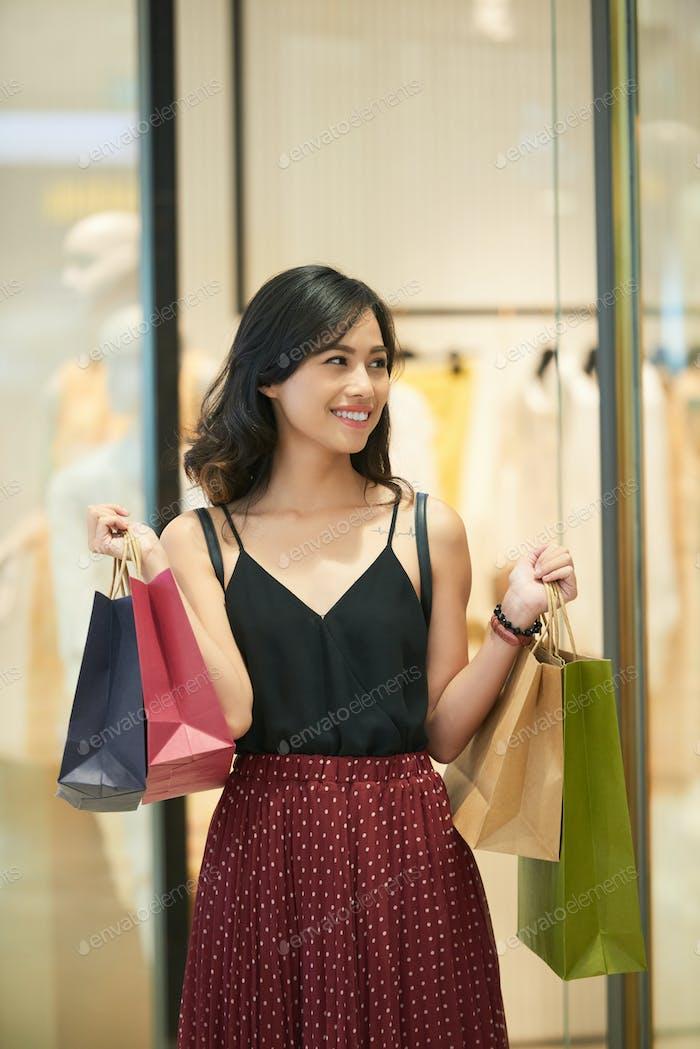 Cheerful female shopaholic