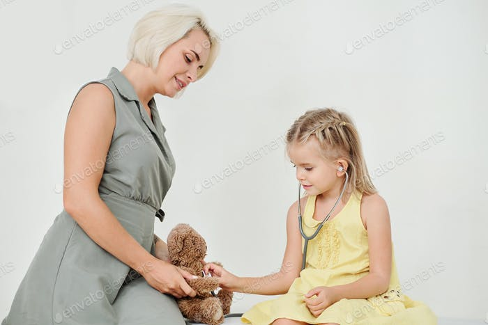 Checking heartbeat of teddy bear