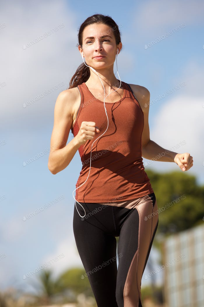 Young sporty woman running outdoors