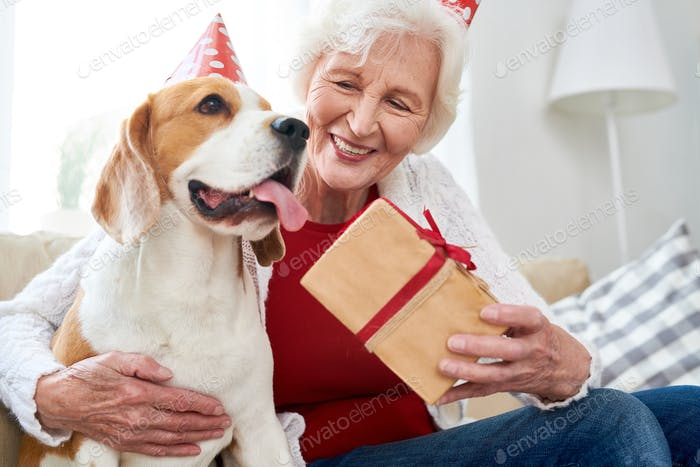 Happy Senior Woman Celebrating Birthday with Dog