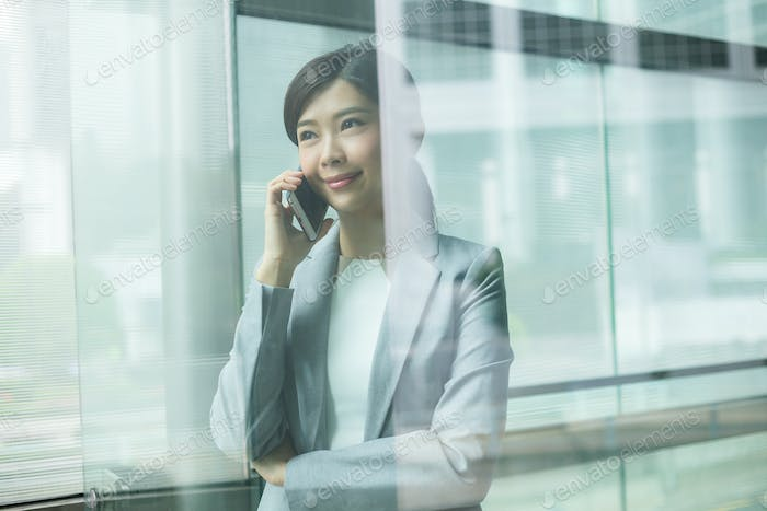 Business woman speaking on cell phone