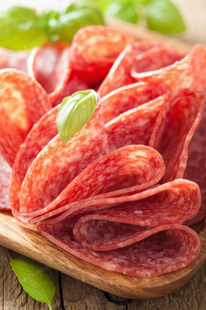 salami slices in wooden plate