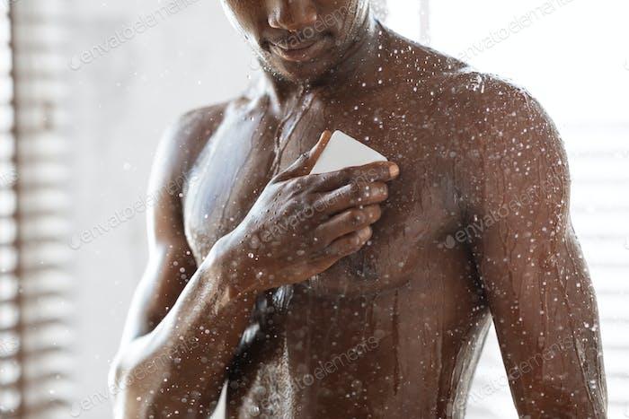 Black Man Washing Bare Torso With Soap Taking Shower Indoor