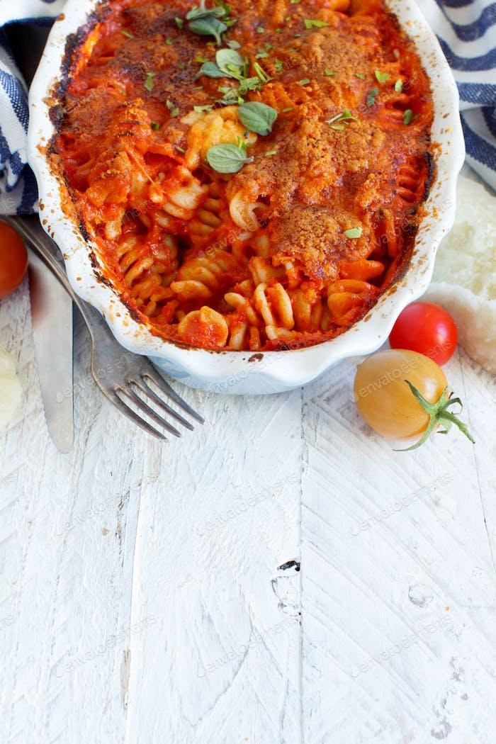 Baked pasta with tomato sauce and mozzarella cheese