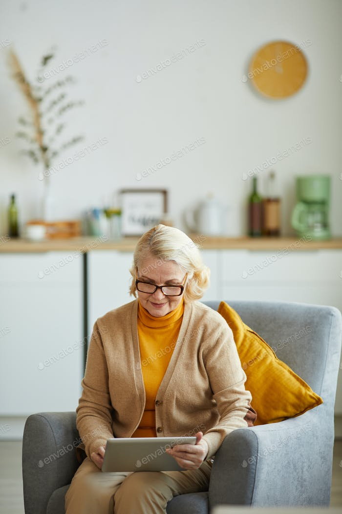 Mature woman using tablet pc