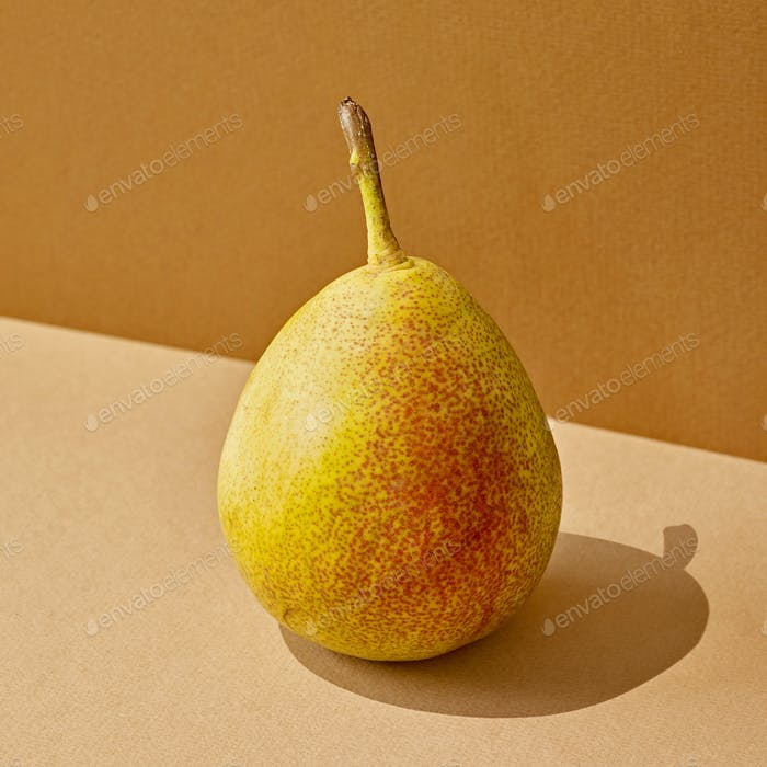 pear with long shadow