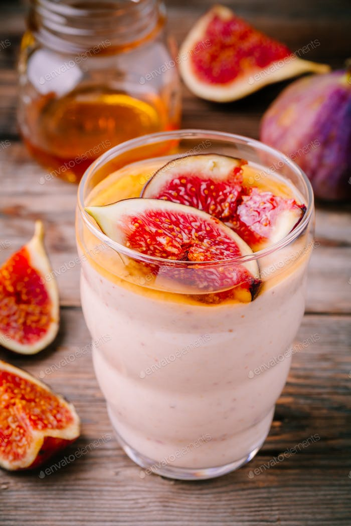 healthy breakfast smoothie with fresh figs and honey in glasses