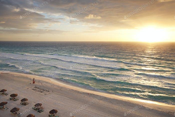 Sunrise on a tropical beach in Cancun Mexico