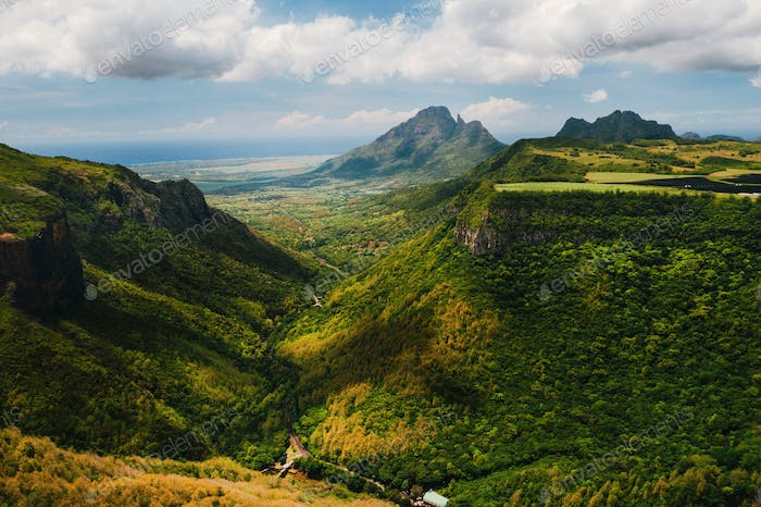 Mountain Landscape of the gorge on the island of Mauritius, Green mountains of the jungle of