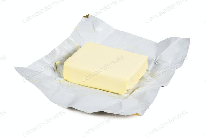 Piece of fresh butter on white background
