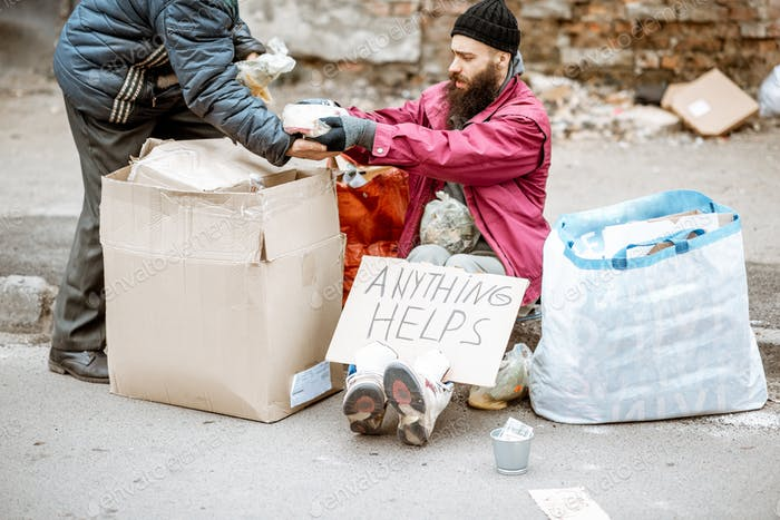 Homeless depressed beggar on the street