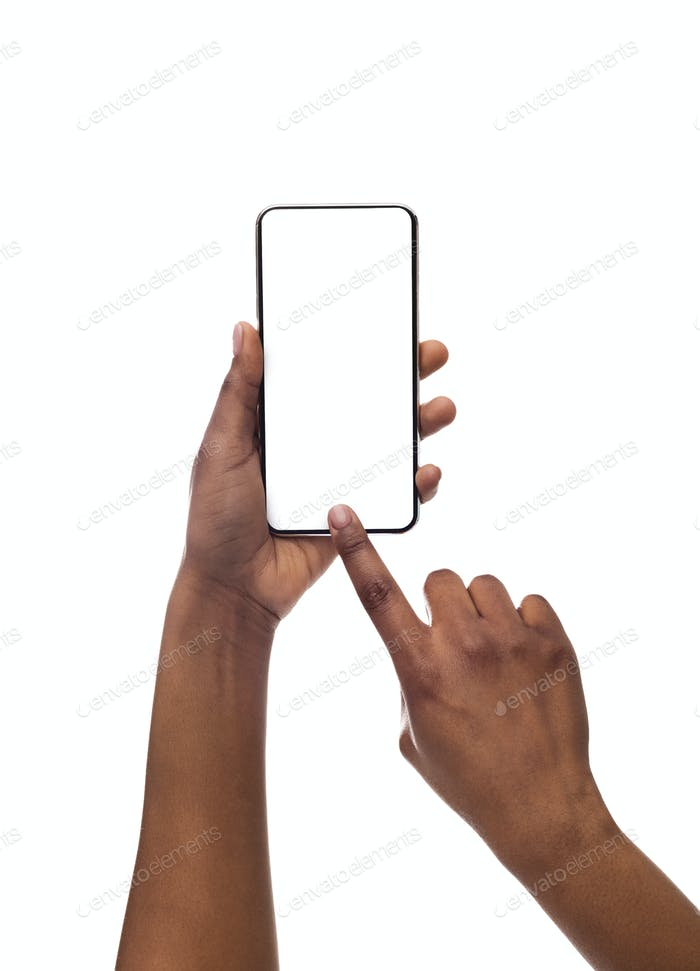 Black female hands taking photo on smartphone with blank screen