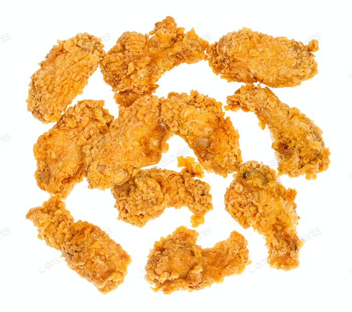 top view of many crispy deep-fried chicken wings