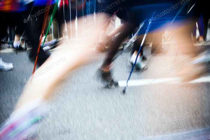 Nordic walking race in city, motion blur