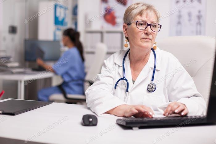 Portrait of experienced senior medic