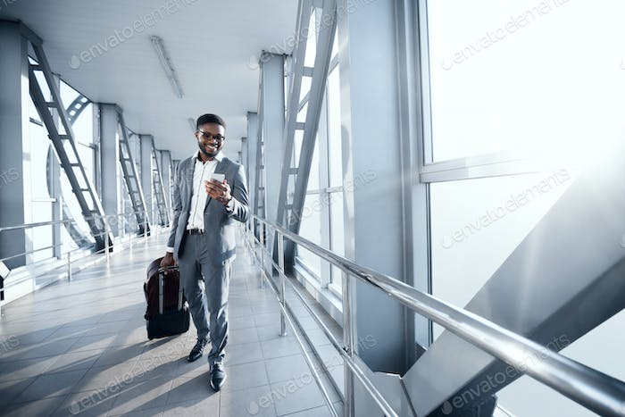 Afro Businessman At Airport Moving To Terminal Gate