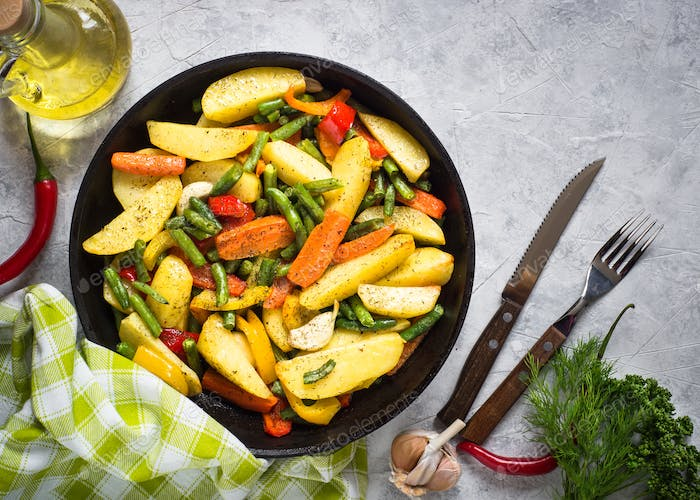 Baked vegetables in black iron plate